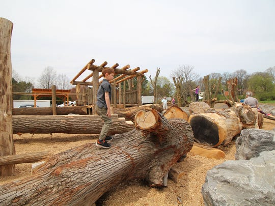 A new playground in Highland Park is made almost entirely from repurposed tree trunks and limbs.