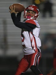 Immokalee quarterback RJ Rosales drops back to pass against Dunbar during a game earlier this season.