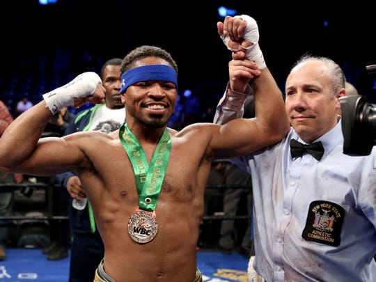 Shawn Porter celebrates after defeating Andre Berto during their welterweight fight.