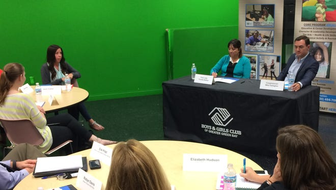 Tonette Walker, left, first lady of Wisconsin, and Rep. Mike Gallagher, right, speak to a group at the Boys & Girls Club of Greater Green Bay about trauma-informed care.