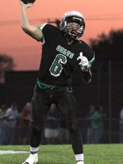 Clear Fork's Jared Schaefer throws a pass while playing