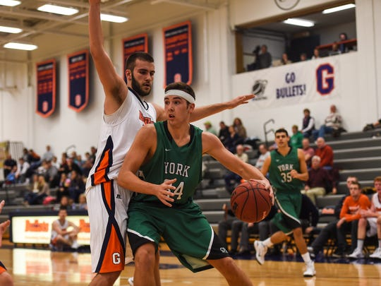 York College's Dalton Myers, front, looks for an opening during a game last season at Gettysburg College. Myers was named Capital Athletic Conference Player of the Week on Monday, Nov. 23, 2015.
