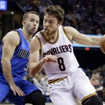 Cleveland CavalierS Matthew Dellavedova drives past Dallas Mavericks' J.J. Barea during a game in Cleveland. Dellavedova has developed into a cult hero this postseason for his hustle.
