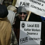 Members of UAW Local 833 picket outside of the American Club Friday November 13, 2015 for a fair contract from Kohler Co. Their old five year contract expires Saturday at midnight.