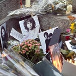 The Doors singer Jim Morrison is buried at Pere Lachaise Cemetery in Paris.