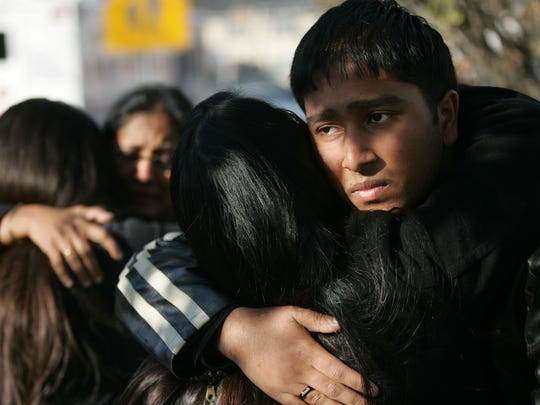 Parishioners were overcome with grief after a gunman fatally shot two people, including his estranged wife, at the St. Thomas Syrian Orthodox Knanaya Church in Clifton on Nov. 23, 2008.