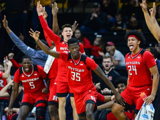 Mar 2, 2019; Iowa City, IA, USA; Rutgers Scarlet Knights forward Issa Thiam (35) and the Scarlet Knights bench react after a three point basket by Thiam during the second half against the Iowa Hawkeyes at Carver-Hawkeye Arena. Mandatory Credit: Jeffrey Becker-USA TODAY Sports