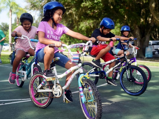 "Alexa Avelar, of Fellsmere, participated in a bike rodeo, Friday, Aug. 4, 2017, at a community event held by the Fellsmere Action Community Team at Grant Park in Fellsmere. ""Florida is the worst state in the country for bicycle safety for a variety of reasons,"" said Phillip Matson, staff director for the Metropolitan Planning Organization."