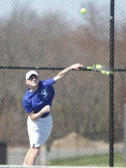 Hen Hud's Adam Kissner delivers a serve during the San Marco Tournament at Harrison High School on Sunday, April 17th, 2016.