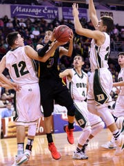 Bloomfield's Ty Padilla is met at the rim by West Las Vegas' D.J. Bustos (12) and Fenix Young during their 4A state quarterfinal game on March 9 at Santa Ana Star Center in Rio Rancho.