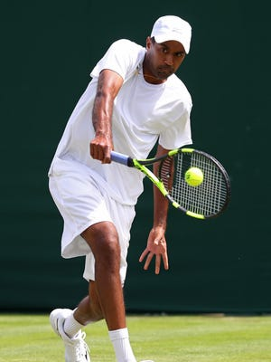 LONDON, ENGLAND - JUNE 28:  Rajeev Ram of The United States plays a backhand during the Men's Singles first round match against Feliciano Lopez of Spain on day two of the Wimbledon Lawn Tennis Championships at the All England Lawn Tennis and Croquet Club on June 28, 2016 in London, England.