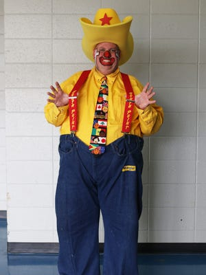 """Justin """"Wrangler"""" Spinks, of Jonesville, poses for a portrait at the Monroe Civic Center on Saturday, March 4, 2017. """"When I was a kid I had a passion to go to rodeos, circuses and I'd always pay attention to the clown. Clowns was my main thing. I just watched them, I studied them. Rodeo clowns like Rudy Burns, Lecile Harris and many more clowns. Bozo on TV. And just studied them and said, 'That's what I want to do.'"""
