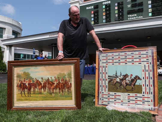 Casey Clements of Louisville brought out a Currier & Ives print from the 1880s of African-American jockeys as well as a Kentucky Derby scene painted on silk that has each Derby winner and their lineage through 1964.