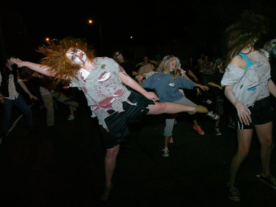 """Zombies"" stop to dance to Michael Jackson's ""Thriller"" in the middle of Main Street in downtown Alexandria during a past Zombie Walk."