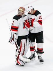 New Jersey Devils goalie Keith Kinkaid (1) celebrates