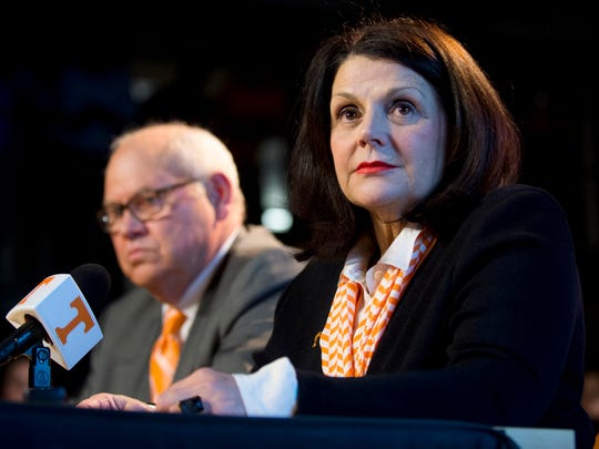 University of Tennessee Chancellor Beverly Davenport, right, and Phillip Fulmer listen during a press conference, Friday, Dec. 1, 2017, in Knoxville, Tenn., where Fulmer was named athletic director at the university. The university placed former AD John Currie on paid leave amid what has been a tumultuous and embarrassing football coaching search. (Calvin Mattheis/Knoxville News Sentinel via AP)