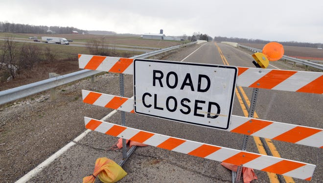 Road closed signs block the Wilson Road bridge over U.S. 33. Thursday afternoon in Greenfield Township. The overpass was closed after it was struck by a semi traveling west on U.S. 33. It will be inspected Friday. The inspection will determine what if any repairs will need to be made and if the bridge can reopen.