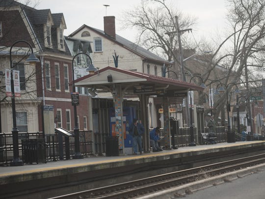 A police officer stood on the tracks at this Burlington City station to stop an oncoming train after a woman threw a child on to the tracks last month.