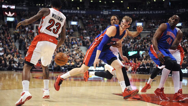 Toronto Raptors guard Lou Williams steals the ball from Detroit Pistons forward Kyle Singler.