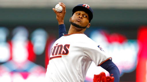 Minnesota Twins pitcher Ervin Santana throws against the Kansas City Royals in the first inning of a baseball game, Monday, April 3,  in Minneapolis.