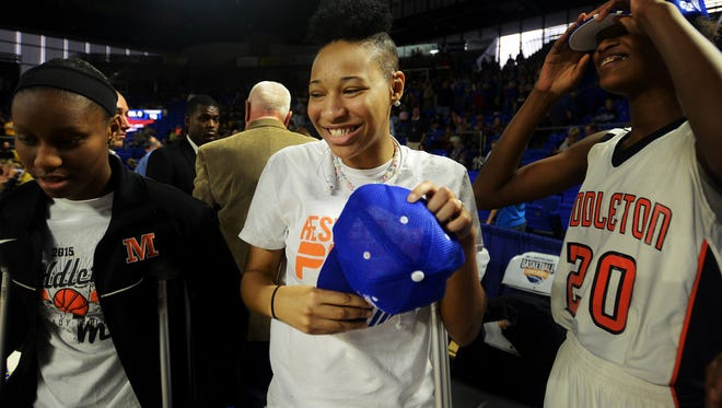 Middleton High School's Deja Faulkner smiles as she receives her 2015 TSSAA Girls' Class A Championship cap after Middleton defeated Clarkrange, 62-50 to become the 2015 TSSAA Girls' Class A Champions.