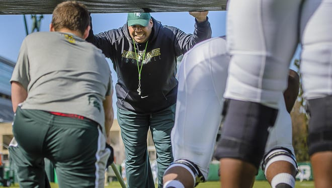 Third-year assistant coach Ron Burton is one of the main reasons MSU's defensive line is considered among the nation's best.