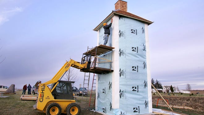 Gilbert Brainard, of Monona, works in 2008 on a chimney swift tower being built next to the National Cemetery, north of Garnavillo along U.S. Hwy 52. The tower is a replica of one constructed by Althea Sherman in the early 20th century.