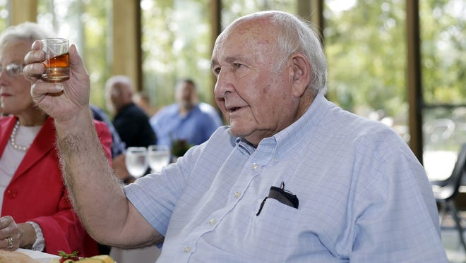 Jimmy Russell raises a toast in honor of his 60 years at Wild Turkey Distillery during the ceremony which inducted him as a lifetime honorary member of the  Kentukcy Distillers Association on Tuesday, Sept.  2, 2014, in Lawrenceburg, KY. (Photo by Tony Tribbble/Invision for Wild Turkey/AP Images)