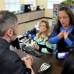 Ky. county clerk defies gay marriage ruling