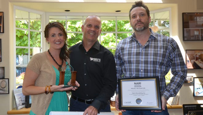 Dale's Remodeling was recognized as a Contractor of the Year winner by the National Association of the Remodeling Industry in the Entire House Under $250,000 category. Pictured left to right is Interior Designer Kendra Porter, Dale's Remodeling President and CEO Dale Van Lydegraf and Designer/Drafter Paul G. Willetts.