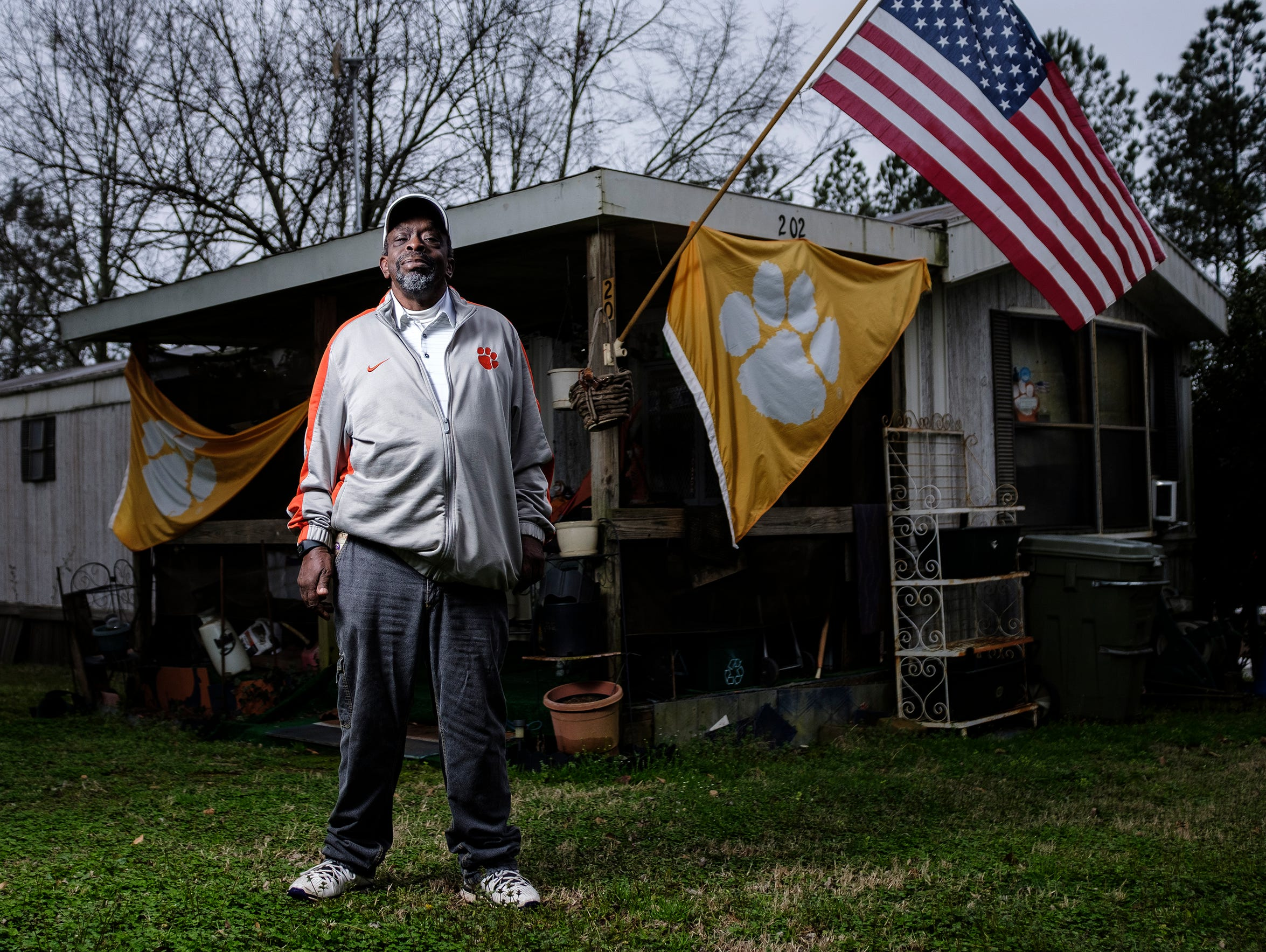 Danny L. Cannon, 63, stands in front of his home in the Calhoun neighborhood in the city of Clemson. Cannon is a diehard Clemson football fan, but he and his neighbors have been feeling increased pressure from living less than two miles from the university. Cannon says the neighborhood is a fraction of the size it was when he first moved there.