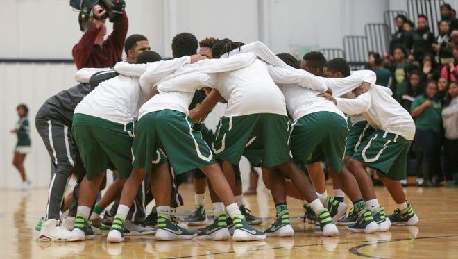 Crispus Attucks boys basketball team huddle up, Jan. 8, 2016.