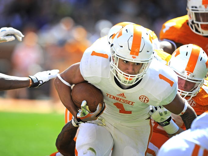 Jalen Hurd (1) pushes through the line as the University of Tennessee plays in the Orange and White game at Neyland Stadium on Saturday April 12, 2014, in Knoxville, Tenn.