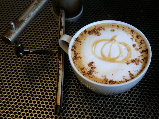 A pumpkin spice latte, made with espresso, steamed