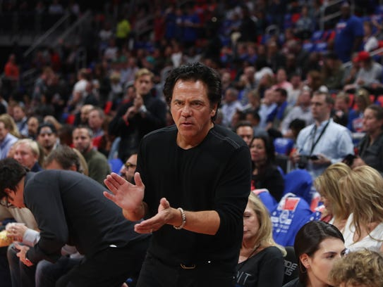 Detroit Pistons owner Tom Gores claps during introductions