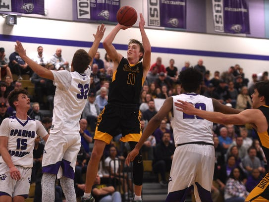 Galena's Moses Wood (11) shoots over Spanish Springs'