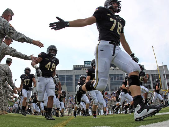Army tackle Brett Toth (78) runs onto the field before