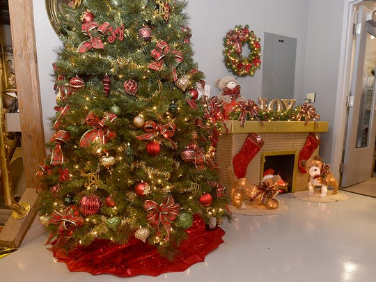 The decorated tree/fireplace ensemble was designed