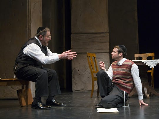 Bob Ari (left) and Miles G. Jackson in a scene from