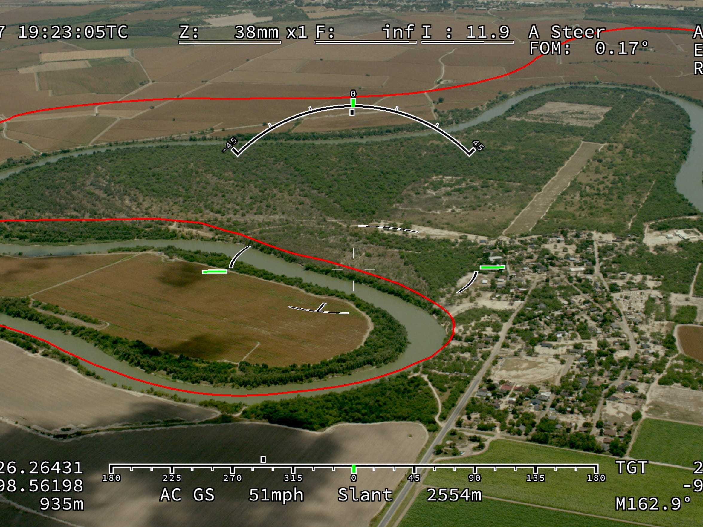 Los Ebanos, Texas, is seen below through the video overlay of the helicopter camera. The red line indicates the border line, which is slightly skewed because of the position of the helicopter.