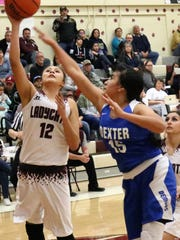 Tularosa's Veronica Diaz, left, attempts a layup while being guarded by Dexter's Tamara Lopez.