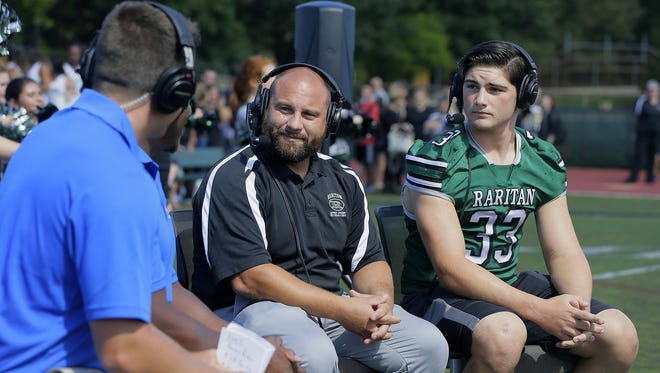 Ryan Ross, host, and Chris Melvin, football recruiting specialist, interview Anthony Petruzzi, Raritan High School football head coach, and Ryan Dickens, Raritan linebacker, during the taping of the Asbury Park Press Red Zone Road Show at Raritan High School in Hazlet, NJ Monday September 12, 2016.