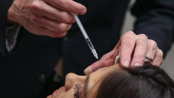 Dr. Mark Hamilton, a facial plastic surgeon and reconstructive surgeon, demonstrates a Botox injection at his office in Greenwood, Ind., Thursday, March 17, 2017. Botox injections are becoming more popular among Gen Exers and Millenials, to smooth out wrinkles and prevent them from deepening with age.