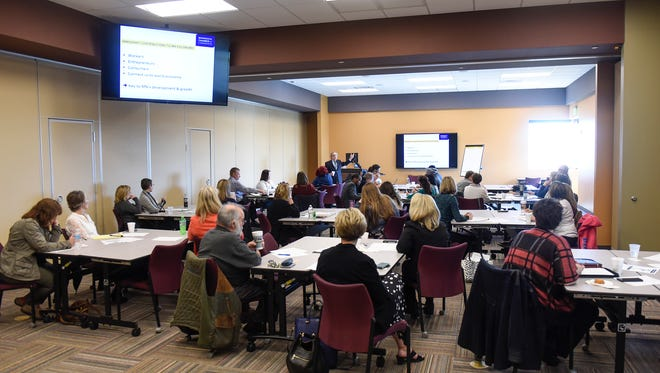 People listen to a presentation on immigration and workforce needs Friday, April 28, in Sartell.