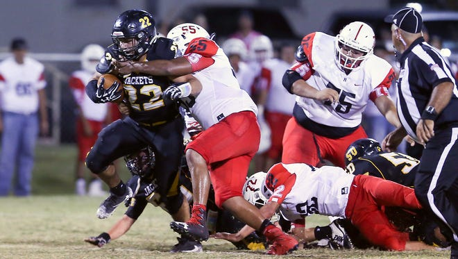 Menard's Tony Ortega (22) powers ahead for yardage against Rocksprings on Sept. 15 in Menard. It was a matchup of teams with six-man enrollment numbers that choose to continue playing 11-man football