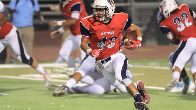 Tulare Western's David Alcantar (C)  (43) rushes for a TD against South-Bakersfield in a non-league high school football game at Bob Mathias Stadium on Sept 22nd, 2017