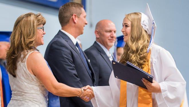 Graduating seniors receive their diplomas.