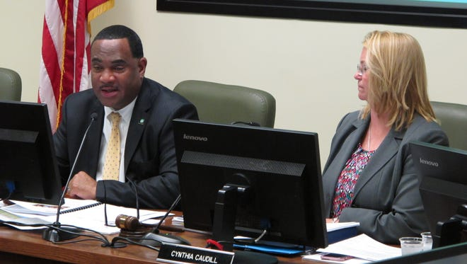 MSD Executive Director Tony Parrott and board chairwoman Cynthia Caudill at Monday's meeting.