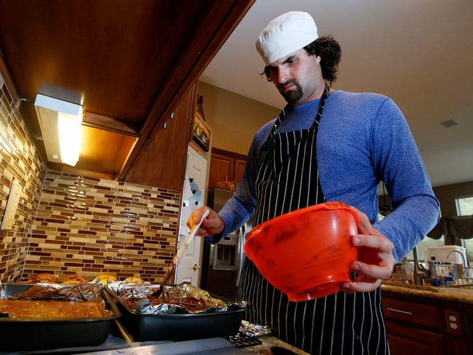 Matt Cottle, owner of Stuttering King Bakery, puts the finishing touches on a fresh batch of brownies in his parents' kitchen, in Scottsdale.