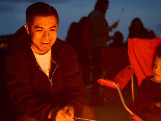 Ivan Roque, 30, of Carson City, roasts s'mores by a fire pit at a previous lantern festival in Fernley.